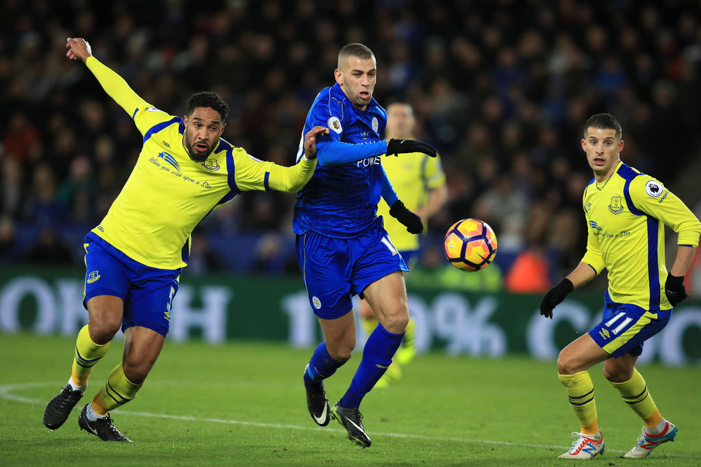 Leicester City's Islam Slimani, center, and Everton's Ashley Williams, left, battle for the ball during the English Premier League socc...