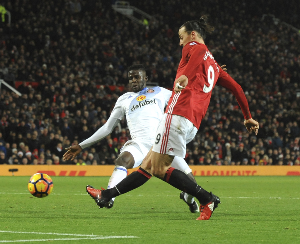 Manchester United's Zlatan Ibrahimovic, right, scores his side's second goal during the English Premier League soccer match between Man...