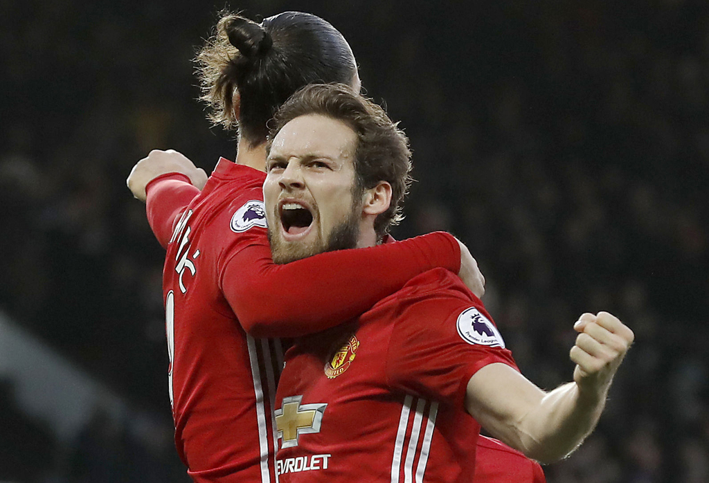 Manchester United's Daley Blind, right, celebrates scoring his side's first goal of the game against Sundeland with teammate Zlatan Ibr...