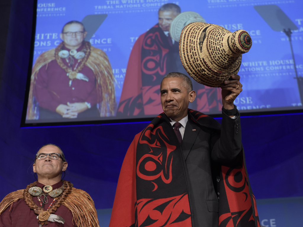 FILE - In this Sept. 26, 2016, file photo, President Barack Obama tips he hat as he stands with Brian Cladoosby, President of National ...