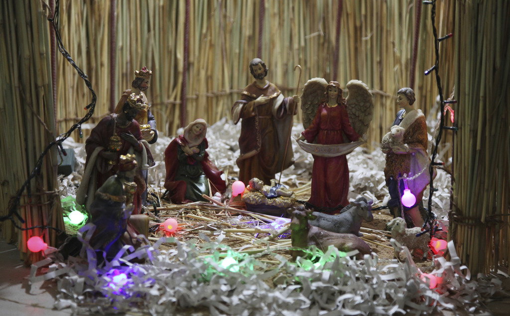 This photo taken Saturday, Dec. 24, 2016, shows a nativity scene during a mass to celebrate Christmas at Philippe Amore Catholic Church...