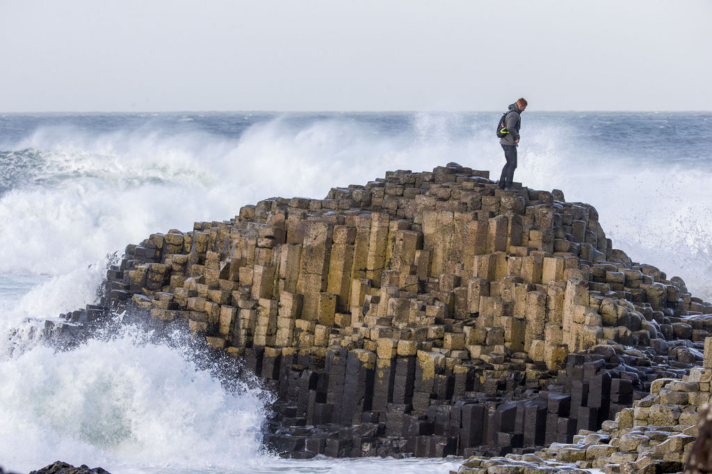 Ron Goubert, a tourist from California, climbs down from The Honeycomb at Giants Causeway in Ballycastle, Northern Ireland, Friday Dec....