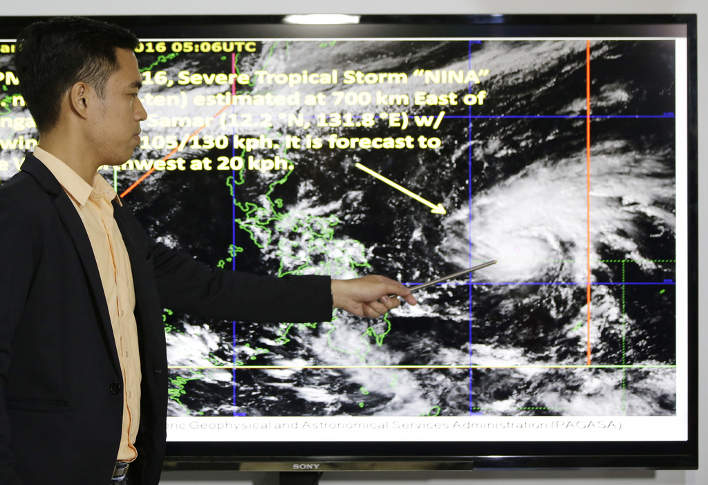Weather specialist Benison Estareja shows the track of Tropical Storm Nock-Ten during a press conference in Quezon city, north of Manil...