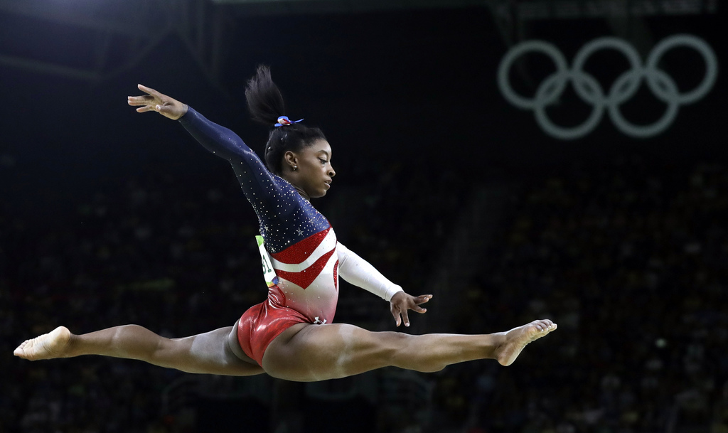 FILE - In this Aug. 9, 2016 file photo, United States' Simone Biles performs on the balance beam during the artistic gymnastics women's...