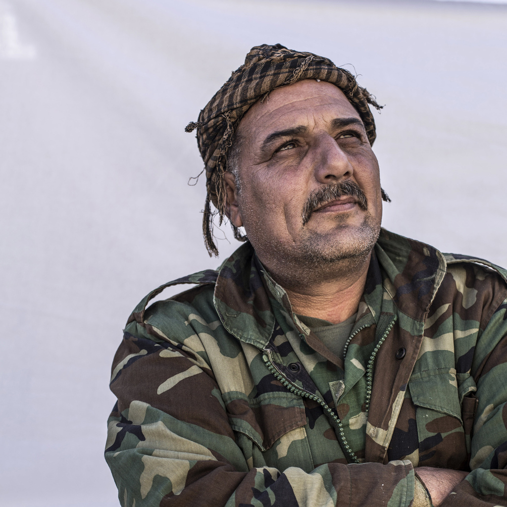 Saad Faraq, 43, a Christian Peshmerga fighters poses for a portrait in a camp where Christians displaced by Islamic State militants are...