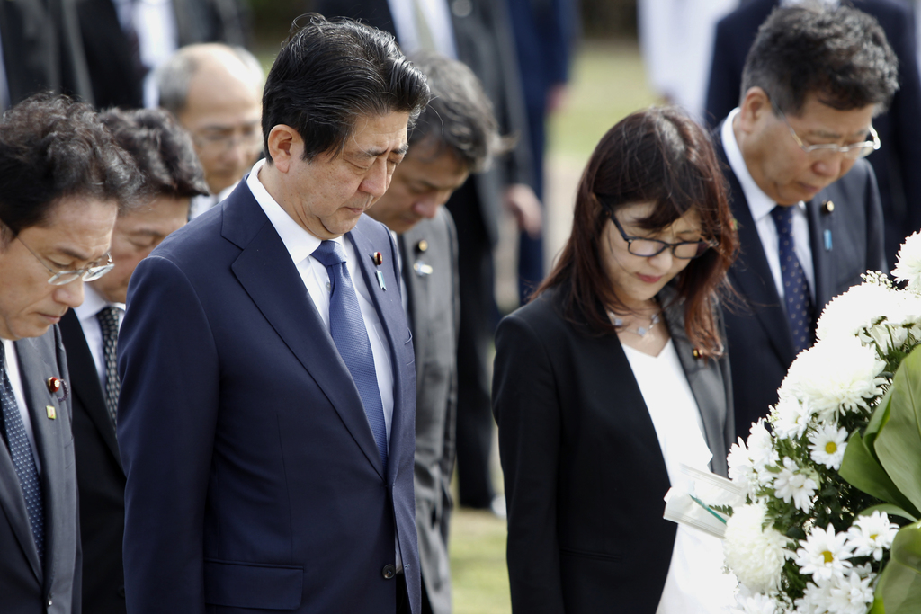 Japanese Prime Minister Shinzo Abe, second from left, Japanese Defense Minister Tomomi Inada, second from right, and Japan's Deputy Chi...