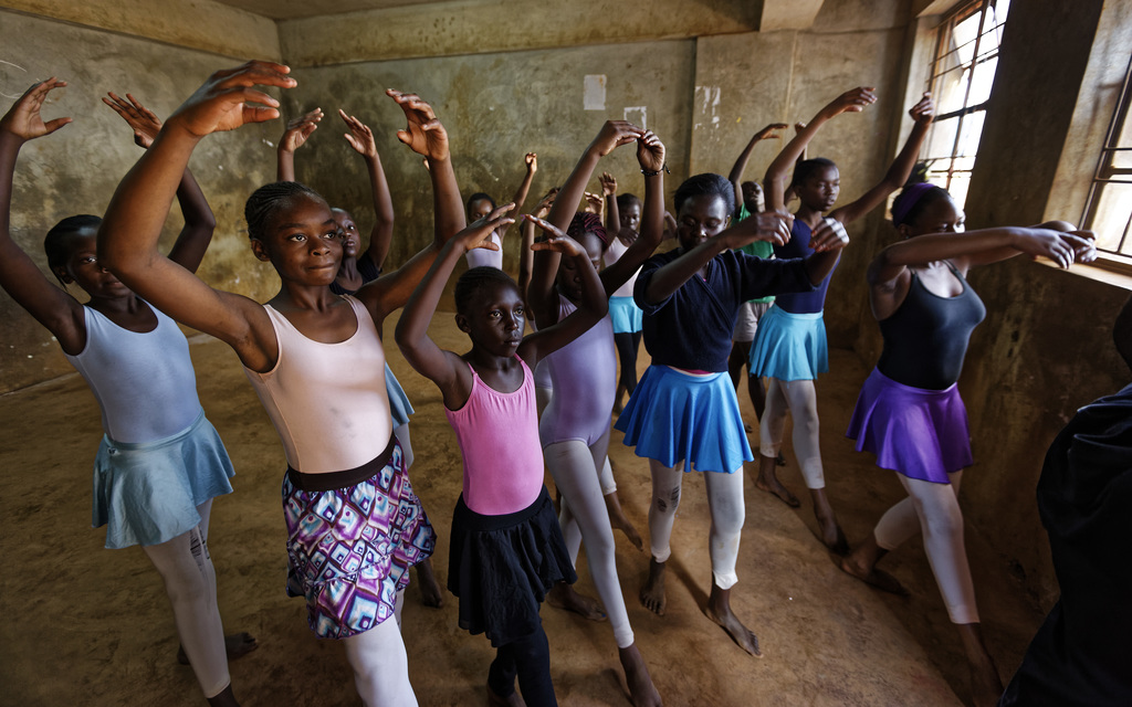 In this photo taken Friday, Dec. 9, 2016, young ballerinas receive instruction from Kenyan ballet dancer Joel Kioko, 16, in a room at a...
