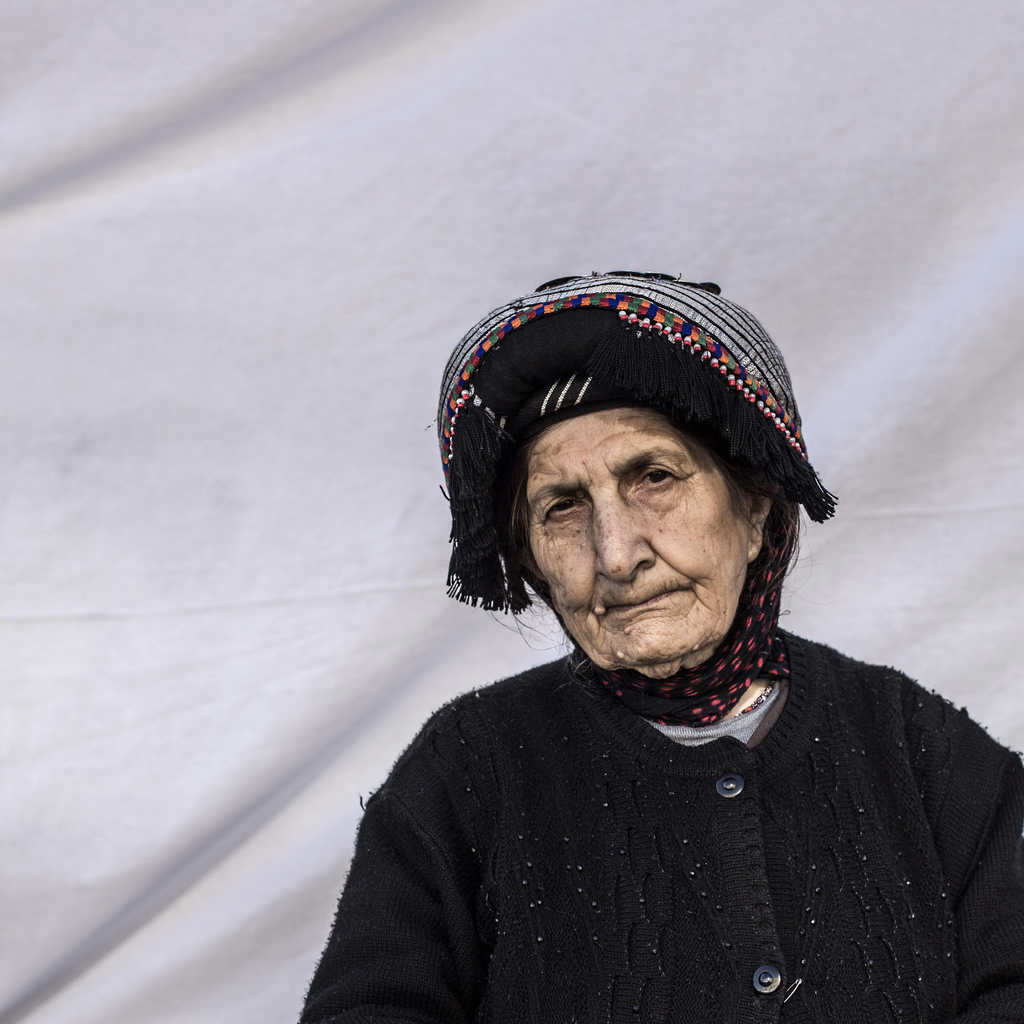 Victoria Behman Akouna, 79, poses for a portrait in a camp where Christians displaced by Islamic State militants are living, in Irbil, ...