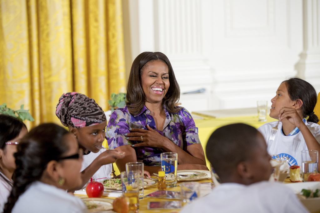 """FILE - In this June 3, 2015, file photo, first lady Michelle Obama talks with children who participated in events with the """"Let's Move!..."""