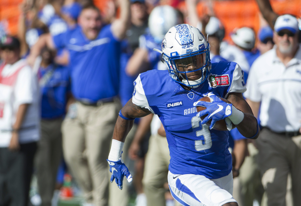 Middle Tennessee wide receiver Richie James (3) runs after catching a pass against Hawaii during the first quarter of the Hawaii Bowl N...