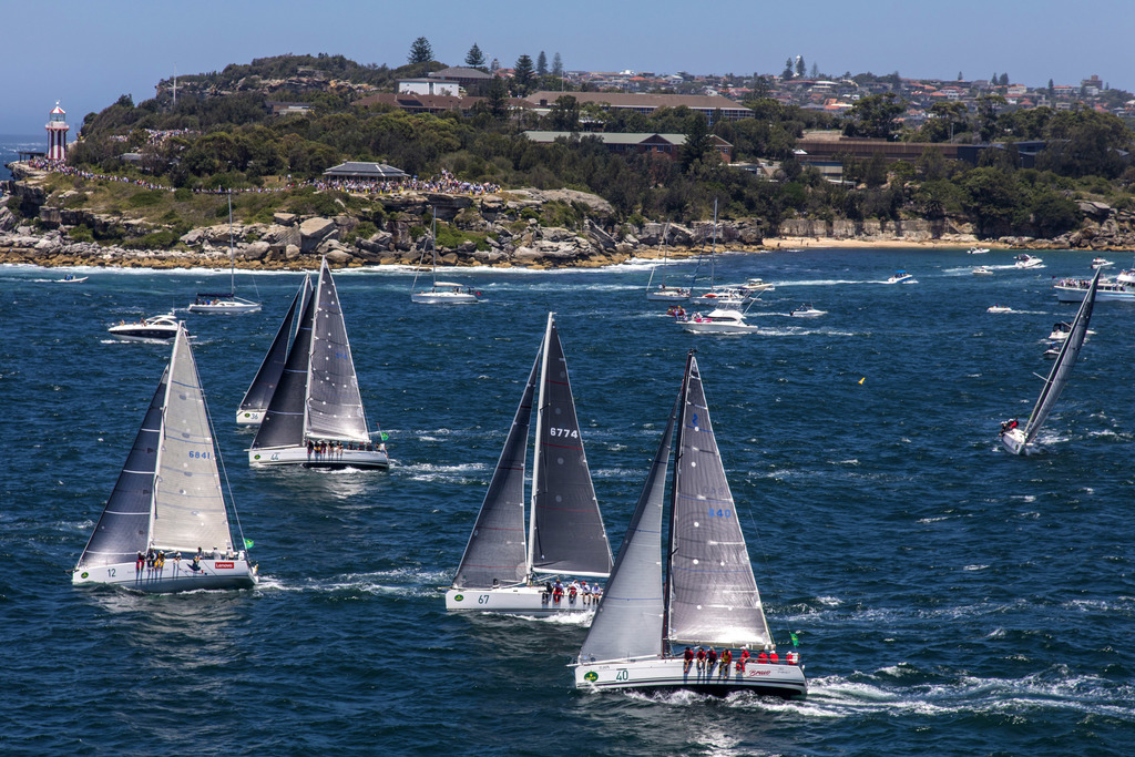 In this photo proved by Rolex, some of the competitors reach the heads of Sydney Harbour during the start of the Sydney Hobart yacht ra...