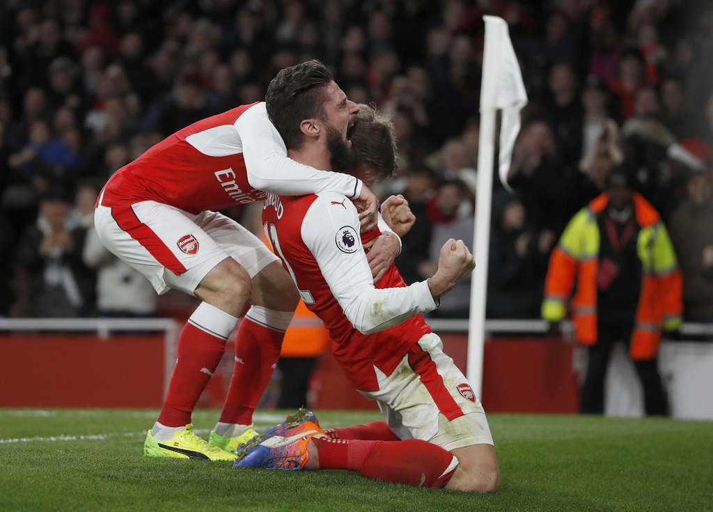 Arsenal's Olivier Giroud celebrates scoring a goal with Arsenal's Nacho Monreal, left, during the English Premier League soccer match b...