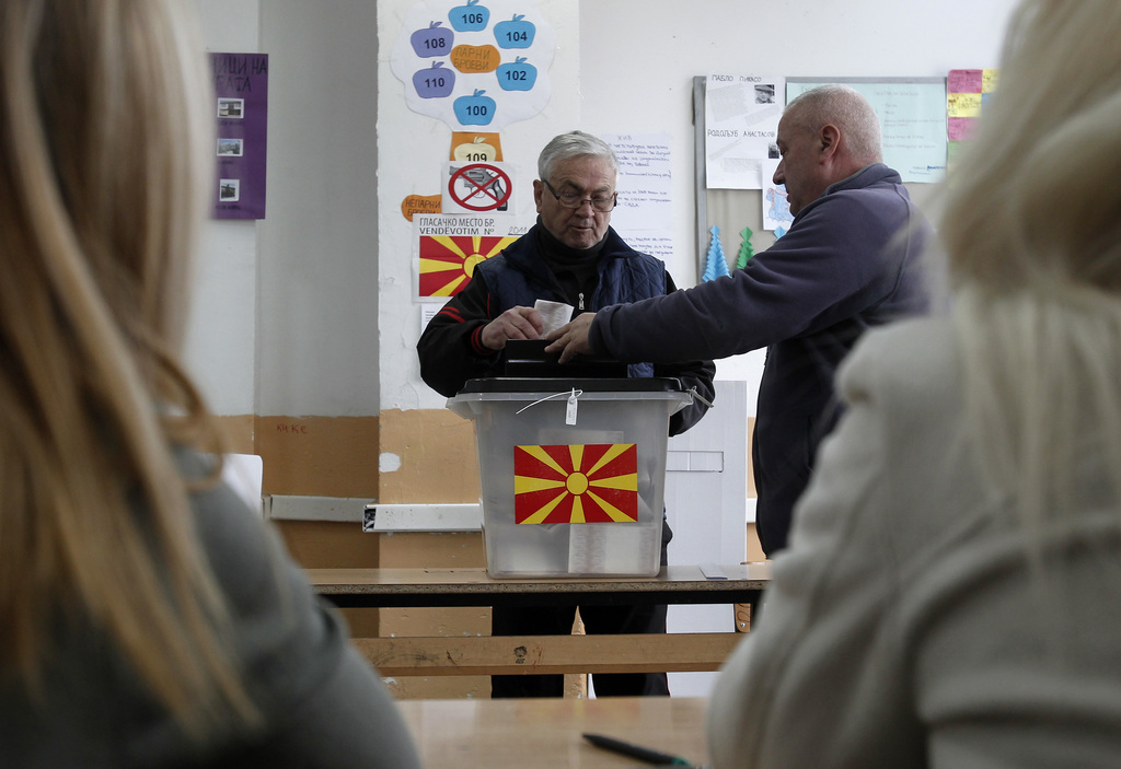 A man casts his ballot at a polling station in village of Tearce, in northwestern Macedonia, on Sunday, Dec. 25, 2016. Authorities in M...