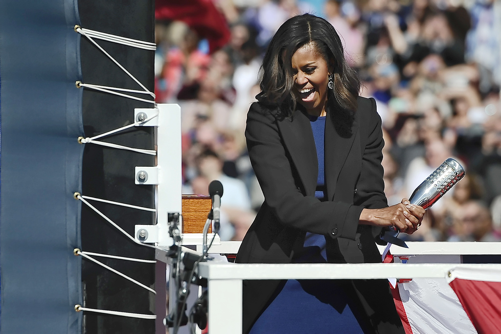 FILE - In this Oct. 10, 2015 file photo, first lady Michelle Obama christens the USS Illinois with a bottle of sparkling wine at Electr...