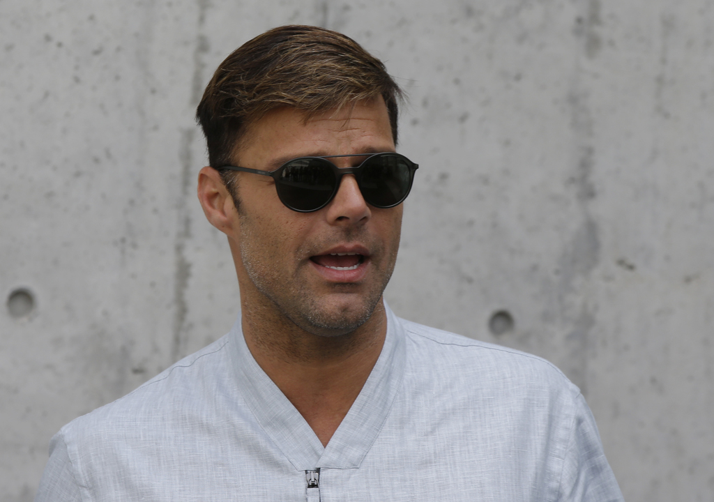 FILE - In this June 21, 2016 file photo, singer Ricky Martin arrives for the Giorgio Armani men's Spring-Summer 2016-2017 fashion show ...