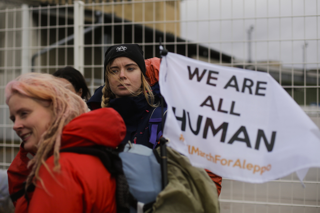 Demonstrators  wait for the launch of the Civil March for Aleppo at the air field of the former airport Tempelhof in Berlin, Monday, De...