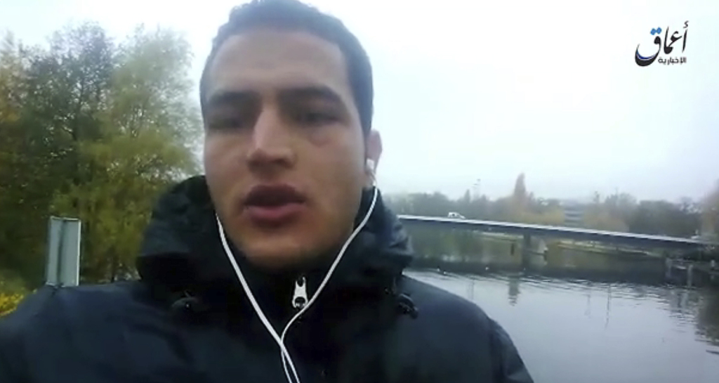 This image made from video released by Amaq News Agency of the Islamic State group on Friday, Dec. 23, 2016 shows Anis Amri, a Tunisian...