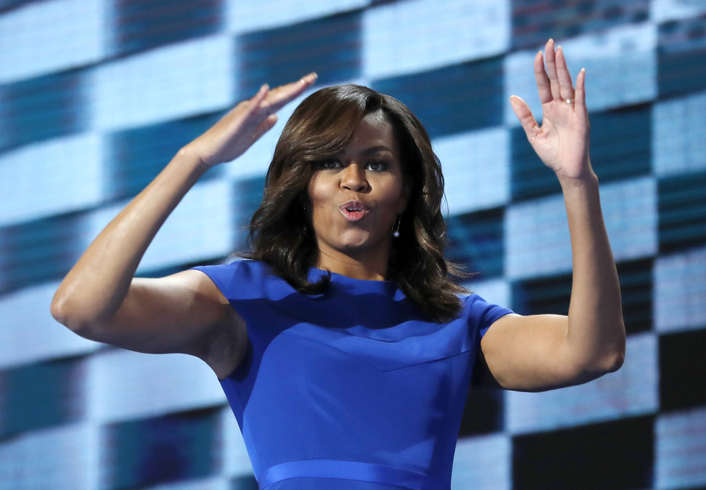FILE - In this July 25, 2016, file photo, first lady Michelle Obama blows kisses after speaking to delegates during the first day of th...