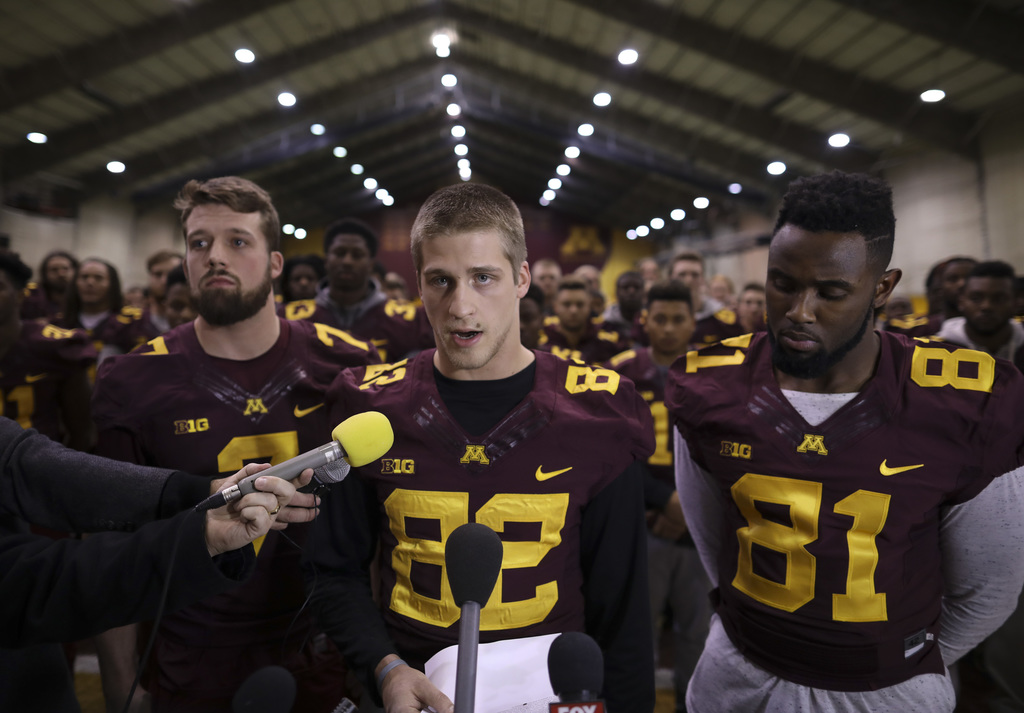 FILE - In this Dec. 15, 2016, file photo, University of Minnesota wide receiver Drew Wolitarsky, flanked by quarterback Mitch Leidner, ...