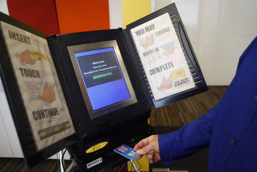 FILE - In this Wednesday, Sept. 28, 2016 file photo, Brian Varner, a principal researcher at Symantec, inserts an identifying chip card...