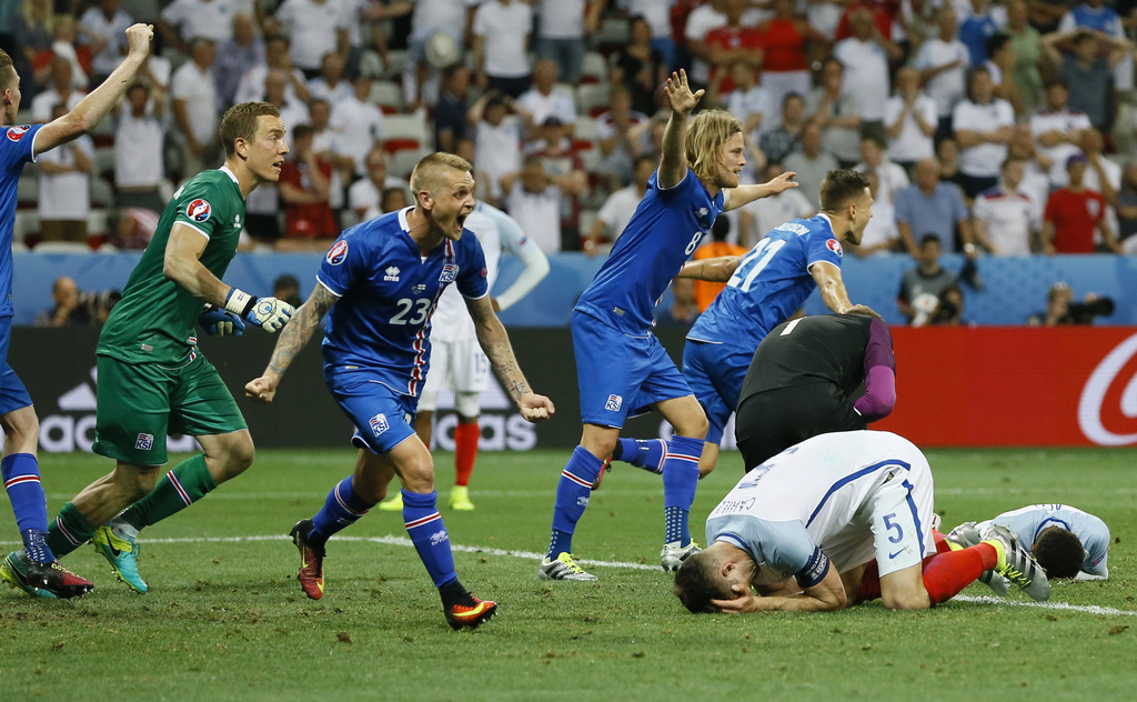 FILE - In this June 27, 2016 file photo, Iceland players celebrate winning at the end of the Euro 2016 round of 16 soccer match between...