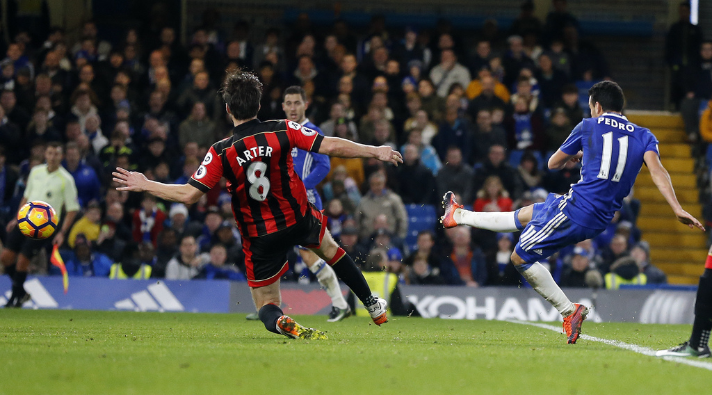 Chelsea's Pedro, right, scores his side's third goal of the game during the English Premier League soccer match between Chelsea and Bou...