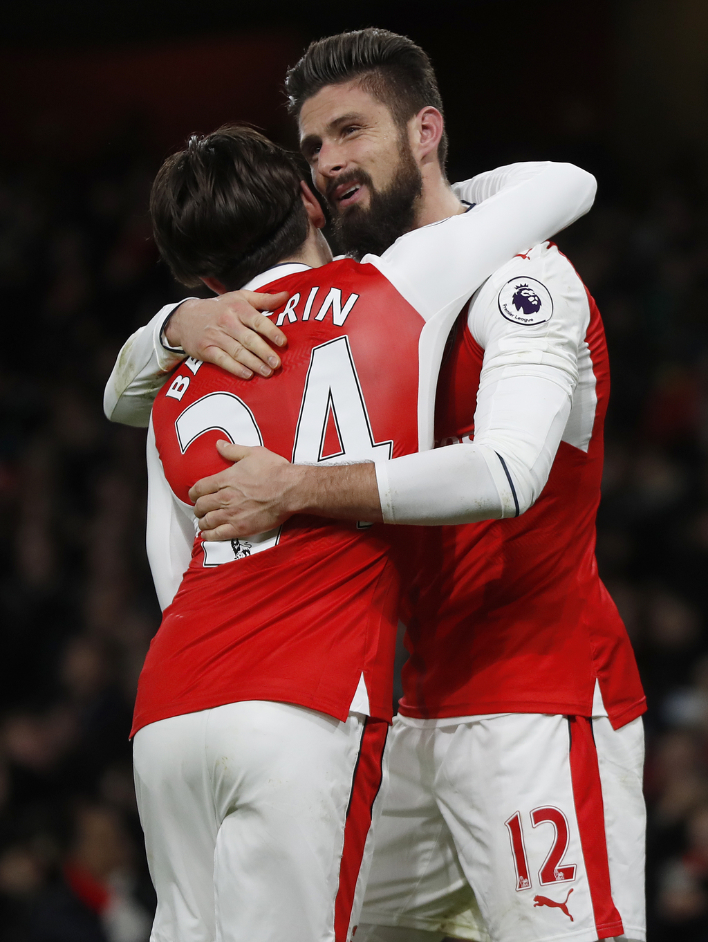 Arsenal's Olivier Giroud,right, celebrates scoring a goal with teammate Hector Bellerin during the English Premier League soccer match ...