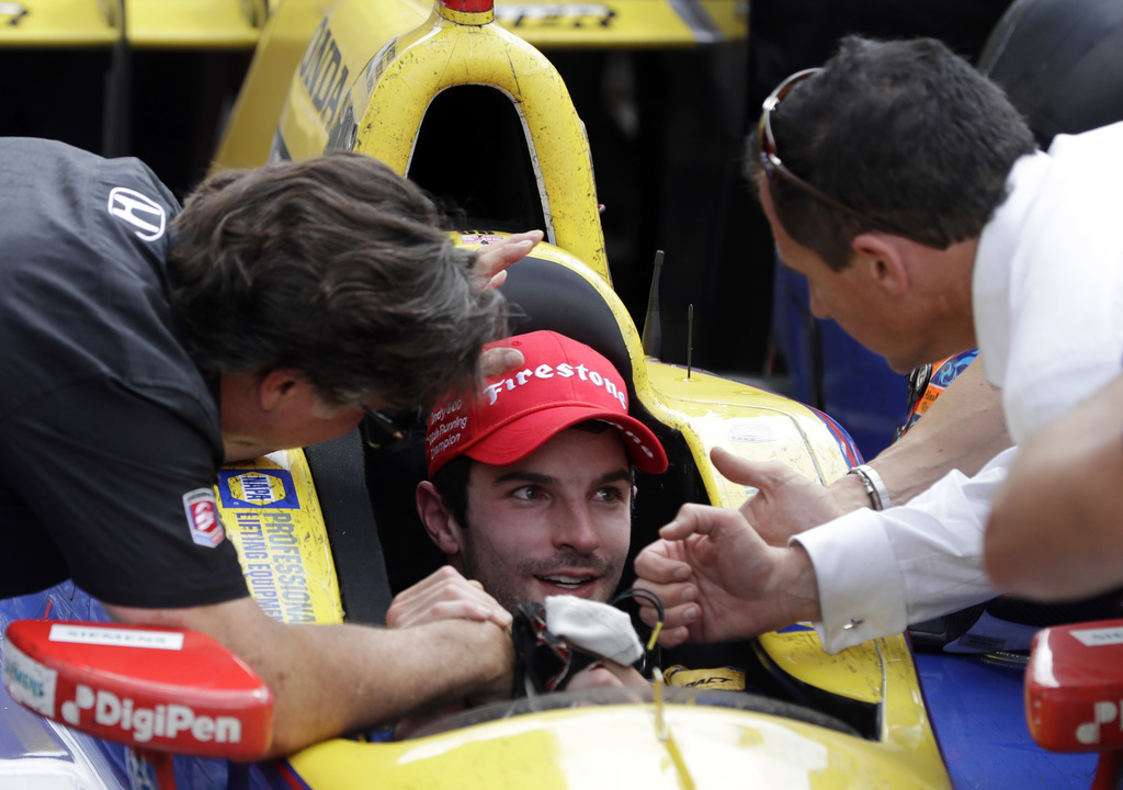 FILE - In this May 29, 2016, file photo, Alexander Rossi, center, celebrates with car owner Michael Andretti, left, after winning the 1...