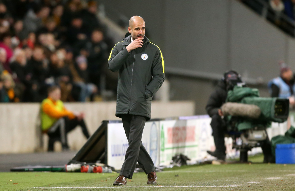 Manchester City manager Pep Guardiola watches the action during their English Premier League soccer match against Hull City at the KCOM...