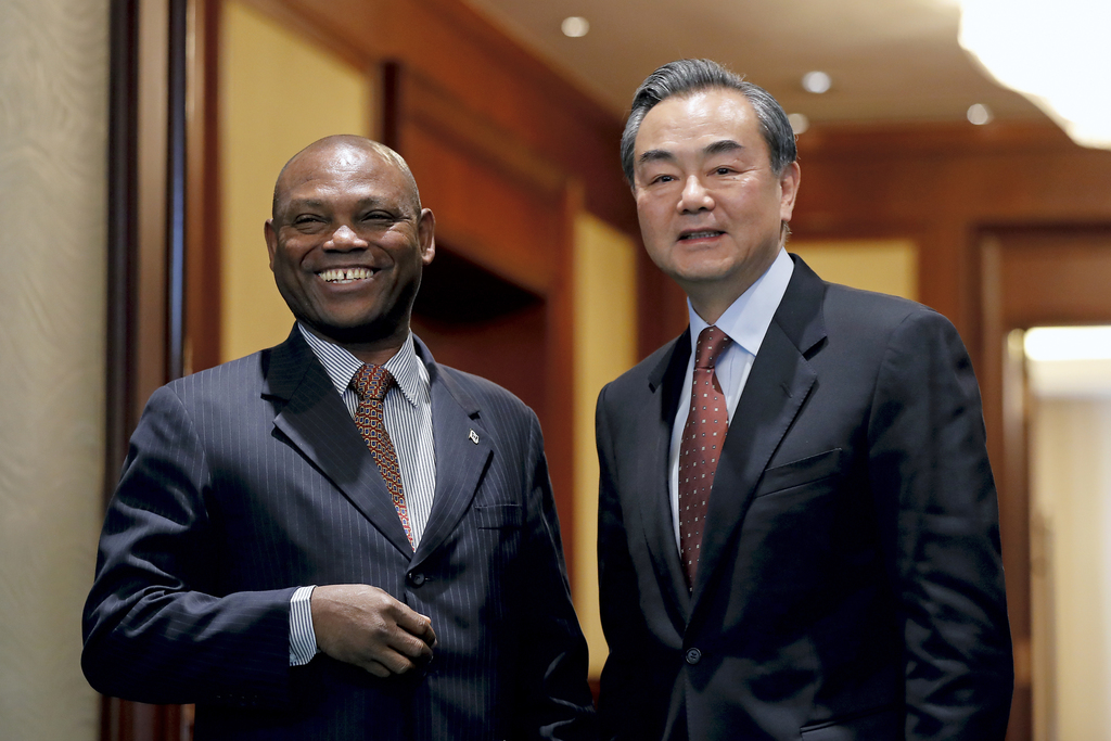 Chinese Foreign Minister Wang Yi, right, shares a light moment with his Sao Tome counterpart Urbino Botelho after a signing ceremony at...
