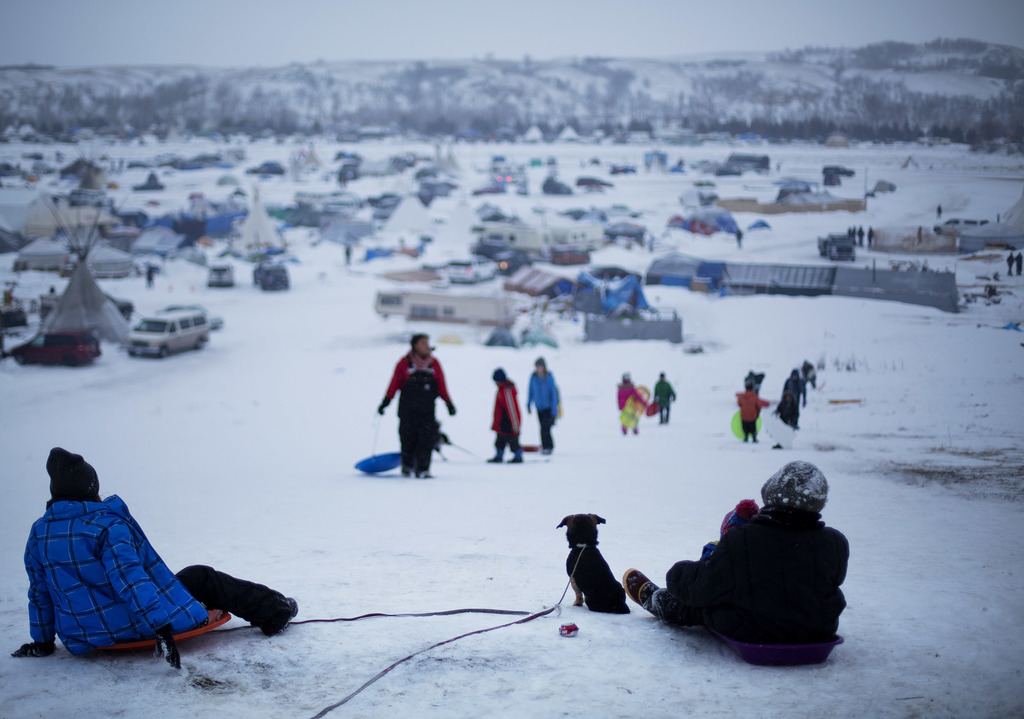 FILE - In this Thursday Dec. 1, 2016 file photo, the Oceti Sakowin camp where people have gathered to protest the Dakota Access oil pip...