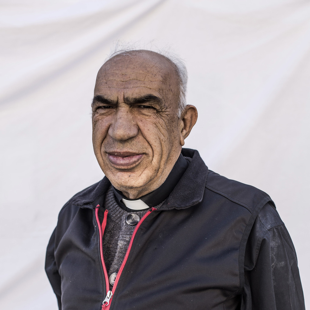 Father Khouri Youssef, 72, a spiritual leader of the community, poses for a portrait in a camp where Christians displaced by Islamic St...