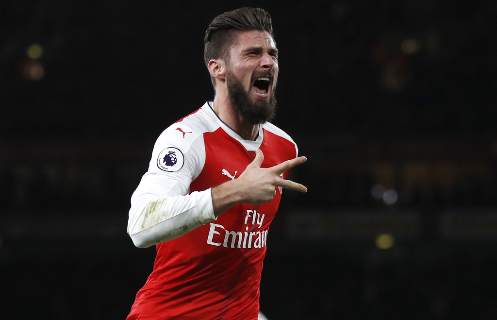 Arsenal's Olivier Giroud celebrates scoring a goal during the English Premier League soccer match between Arsenal and West Bromwich Alb...