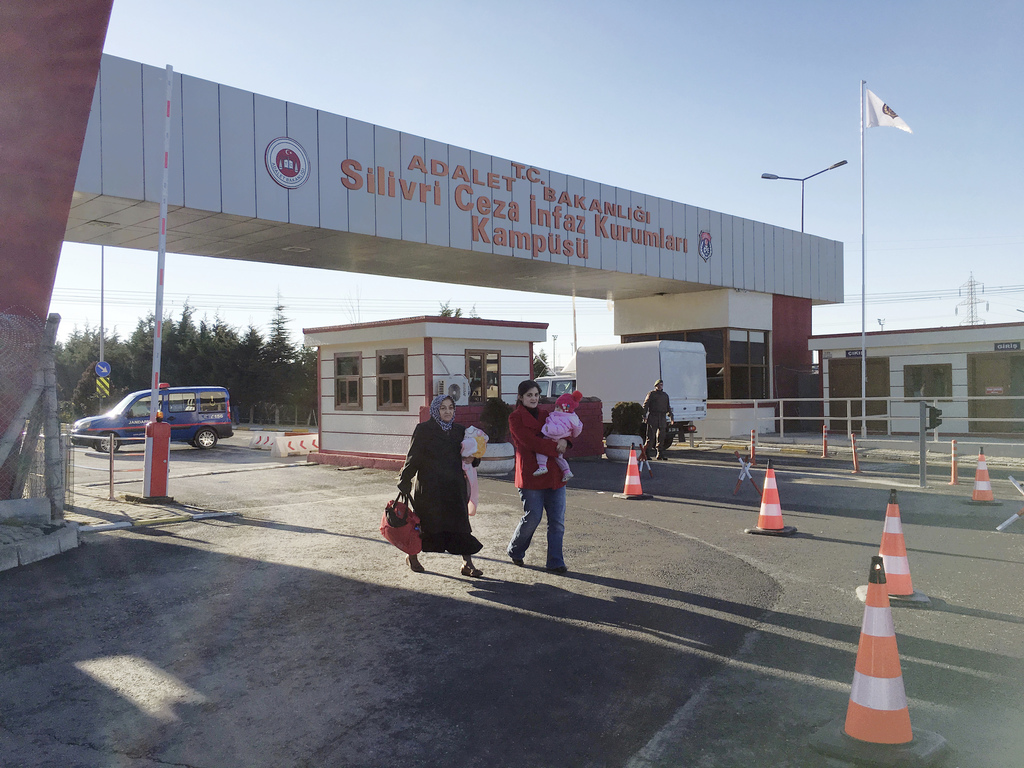 People walk at the entrance of Silivri Prison and Courthouse complex where 29 Turkish former police officers are on trial in the outski...