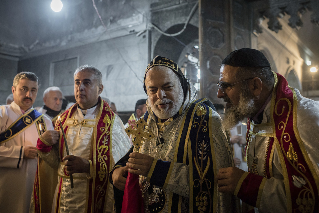 Priests lead a Christmas Eve's Mass in the Assyrian Orthodox church of Mart Shmoni, in Bartella, Iraq, Saturday, December 24, 2016. For...