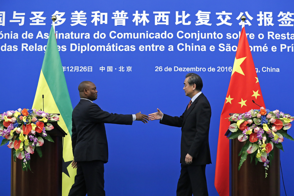 Chinese Foreign Minister Wang Yi, right, prepares to shake hands with his Sao Tome counterpart Urbino Botelho after a joint press state...