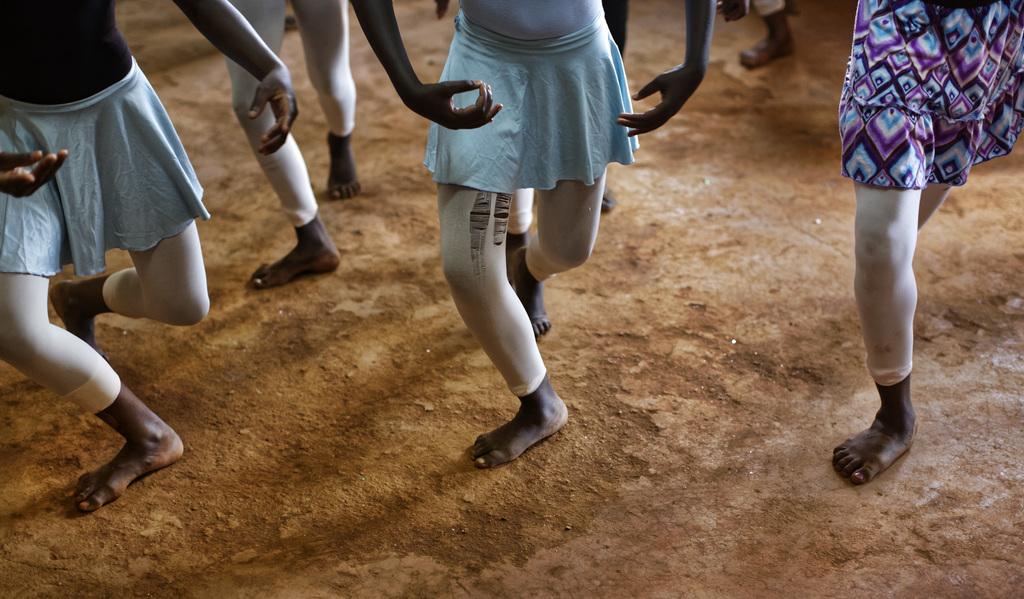 In this photo taken Friday, Dec. 9, 2016, young ballerinas practice under the instruction of Kenyan ballet dancer Joel Kioko, 16, in a ...