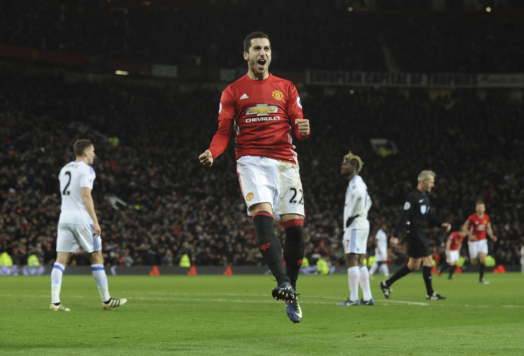 Manchester United's Henrikh Mkhitaryan celebrates after scoring his side's third goal during the English Premier League soccer match be...
