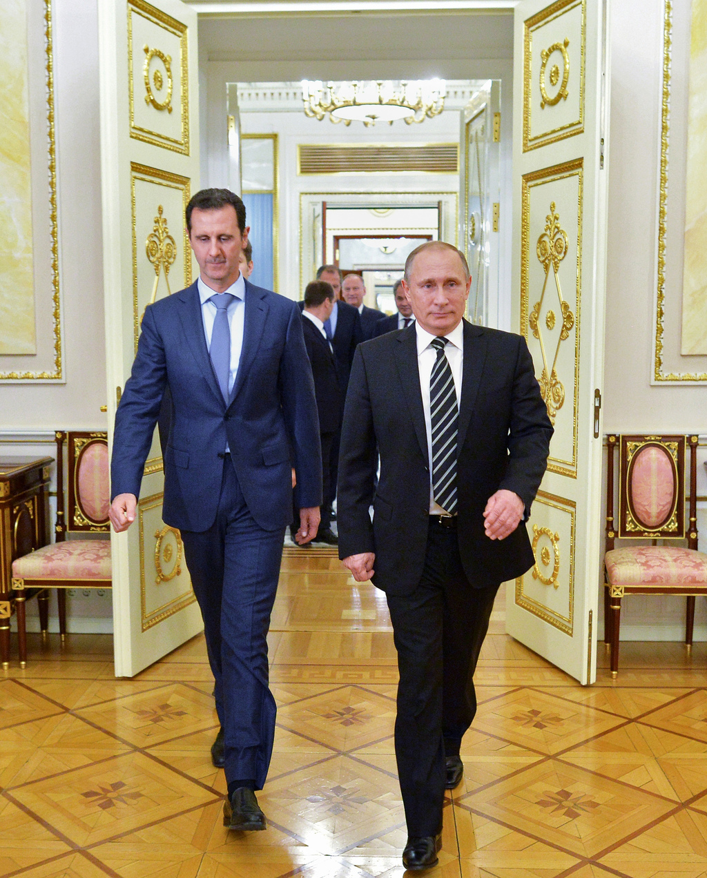 FILE -- In this Oct. 20, 2015 file photo, Russian President Vladimir Putin, right, and Syria President Bashar Assad arrive for their me...