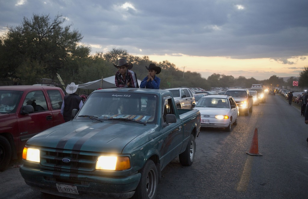 Heavy traffic blocks a road as visitors try to get to a party honoring Rubi Ibarrafor her down-home 15th birthday near the village of L...