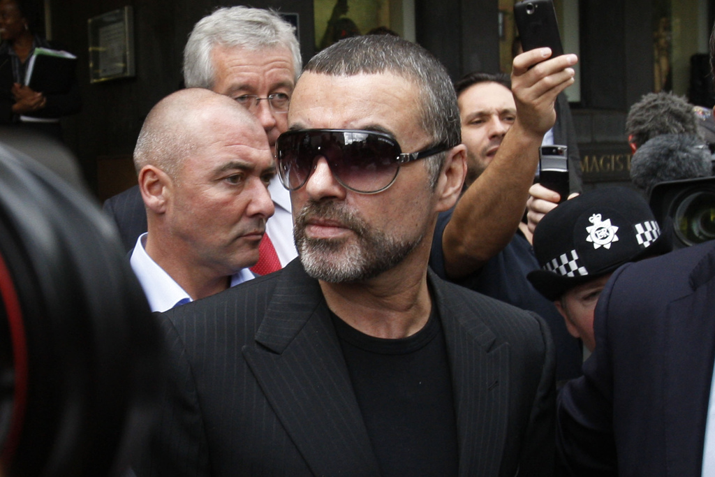 FILE - In this Aug. 24, 2010, file photo, British singer George Michael leaves Highbury Corner Magistrates Court in north London. Micha...