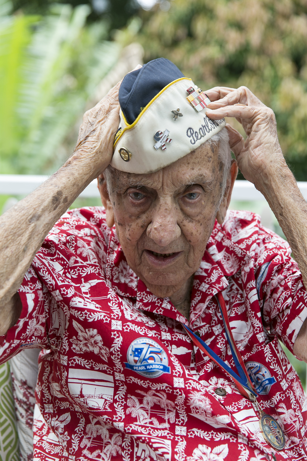 Pearl Harbor survivor Al Rodrigues, 96, is seen in his home, Monday, Dec. 26, 2016, in Kailua, Hawaii. Rodrigues says he welcomes the v...