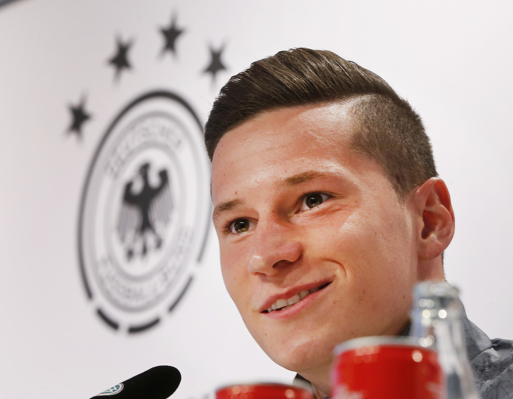 FILE- In this June 12, 2016 file picture national soccer player Julian Draxler speaks during a press conference in Evian, France, where...