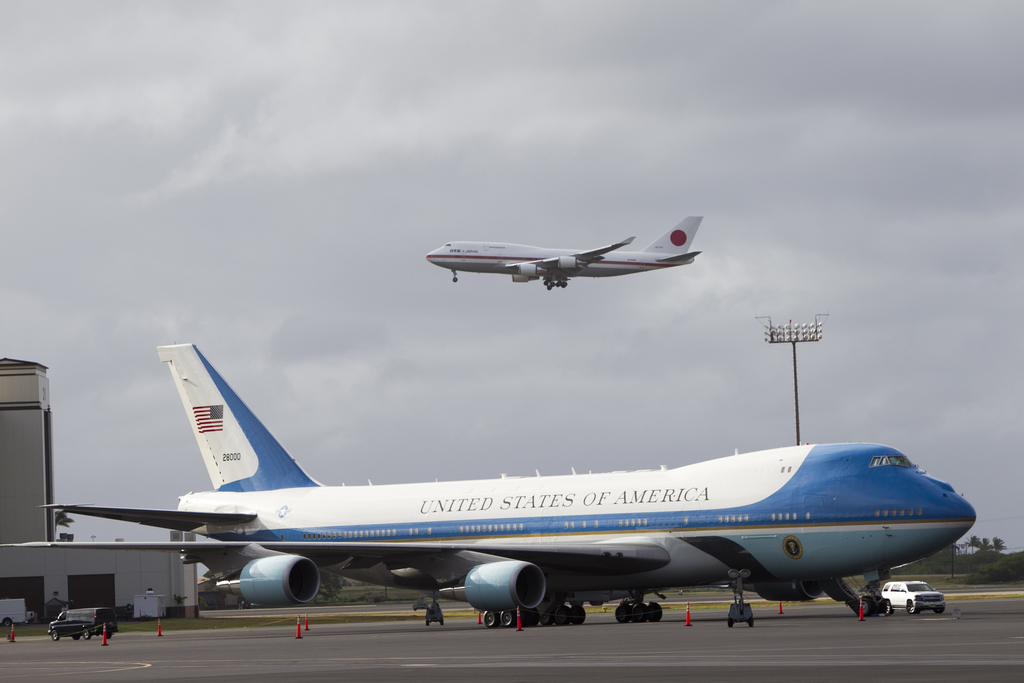 The plane of Japan's Prime Minister Shinzo Abe flies over Air Force One at Joint Base Pearl Harbor Hickam, Monday, Dec. 26, 2016, in Ho...