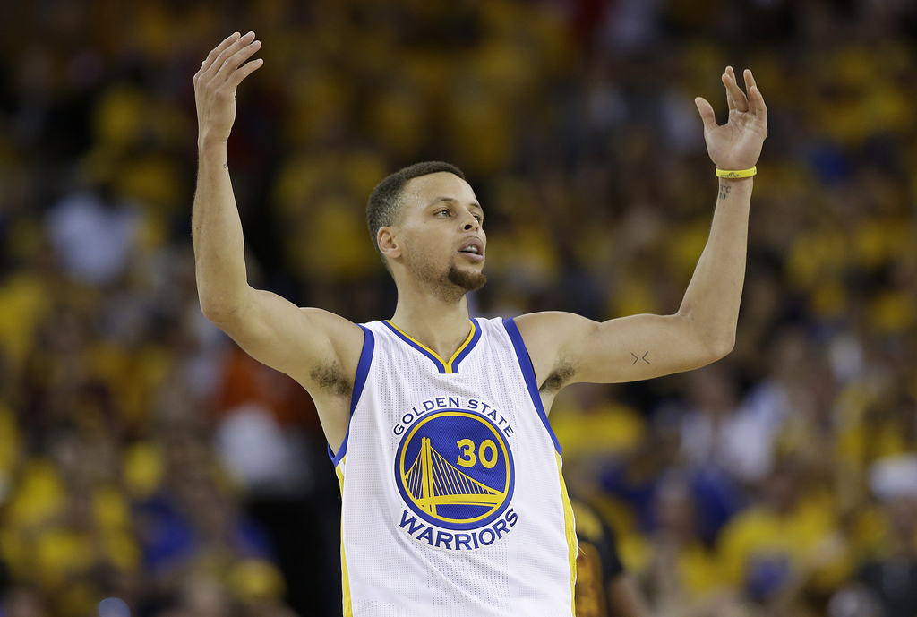 FILE - In this June 19, 2016 file photo, Golden State Warriors guard Stephen Curry (30) gestures after scoring against the Cleveland Ca...