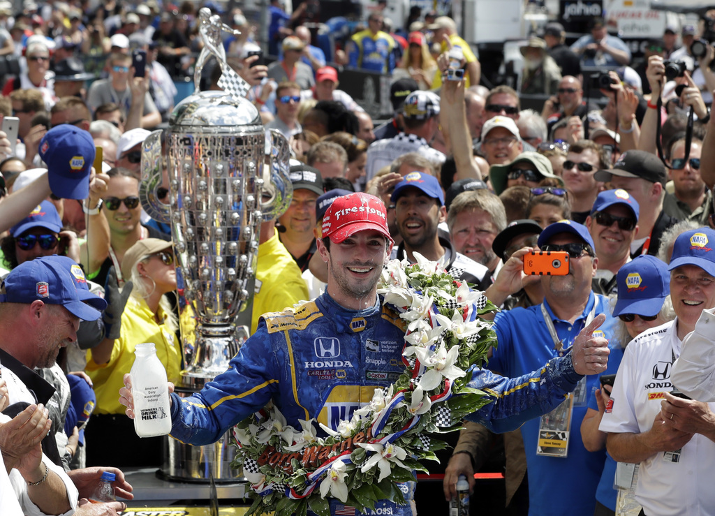 FILE - In this May 29, 2016 file photo, Alexander Rossi celebrates after winning the 100th running of the Indianapolis 500 auto race at...