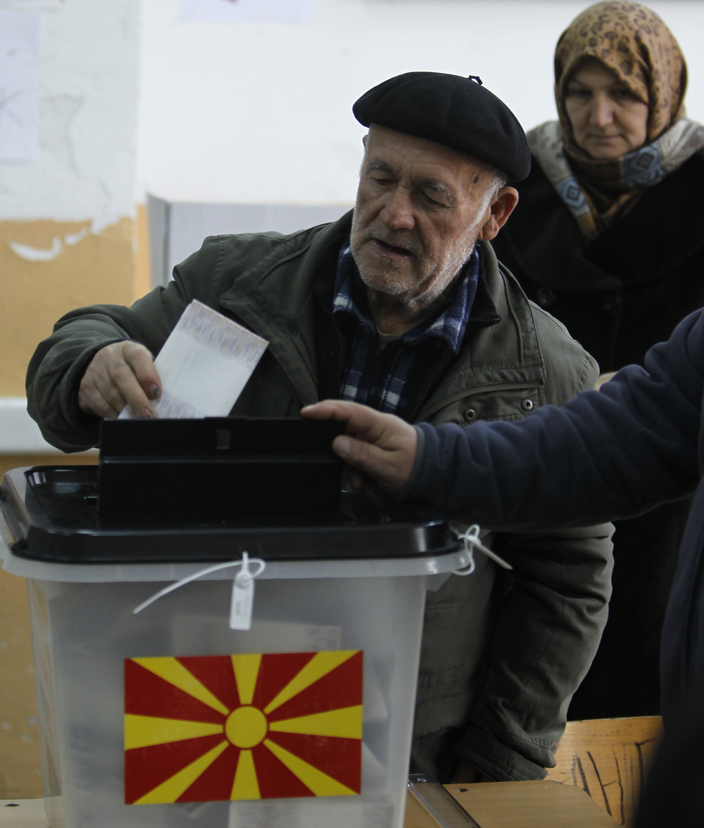 An ethnic Albanian couple vote at a polling station in village of Tearce, in northwestern Macedonia, on Sunday, Dec. 25, 2016. Authorit...