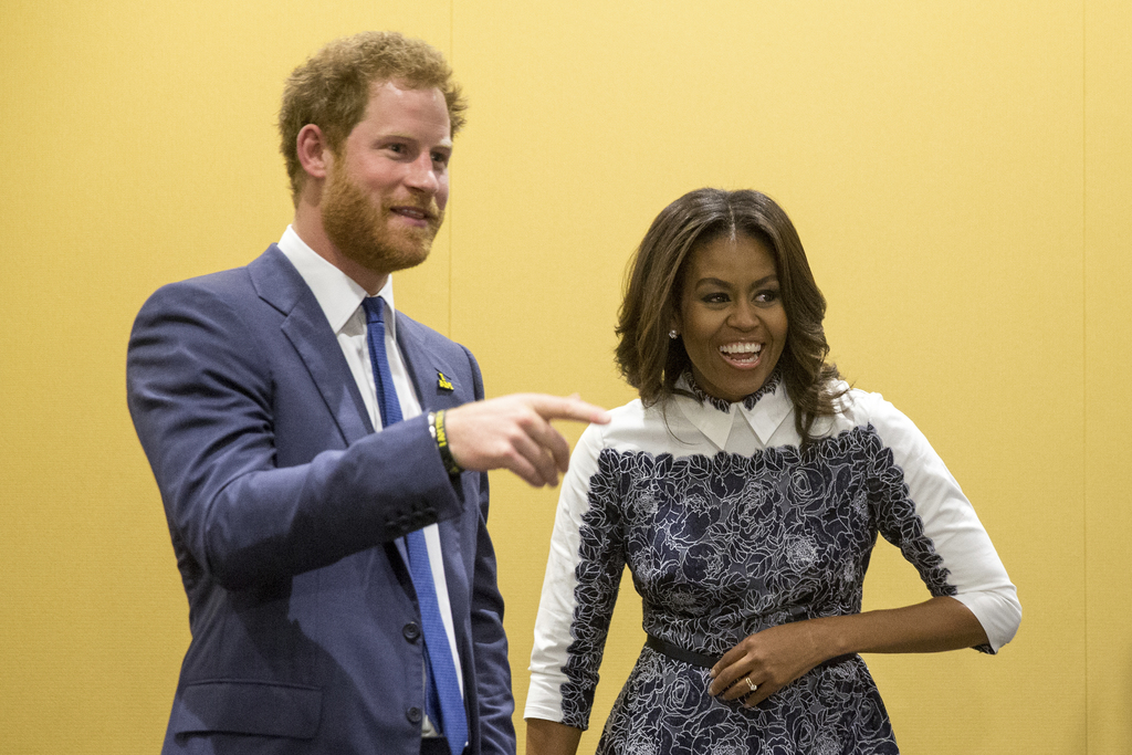 FILE - In this Oct. 28, 2015, file photo, Britain's Prince Harry and first lady Michelle Obama tour the USO Warrior and Family Center a...