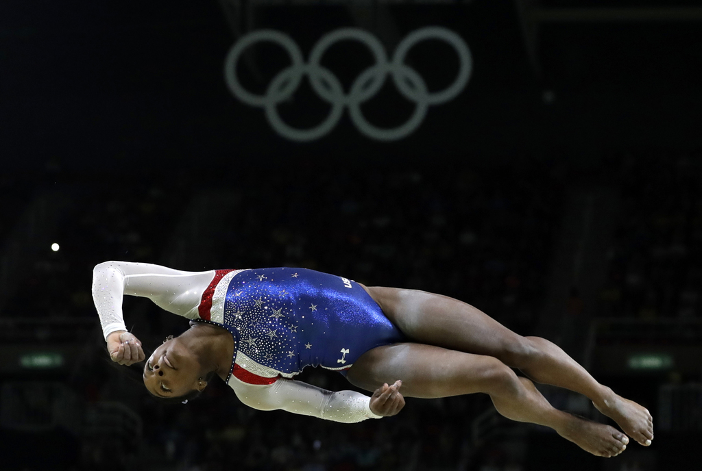 FILE - In this Aug. 11, 2016, file photo, United States' Simone Biles performs on the balance beam during the artistic gymnastics women...