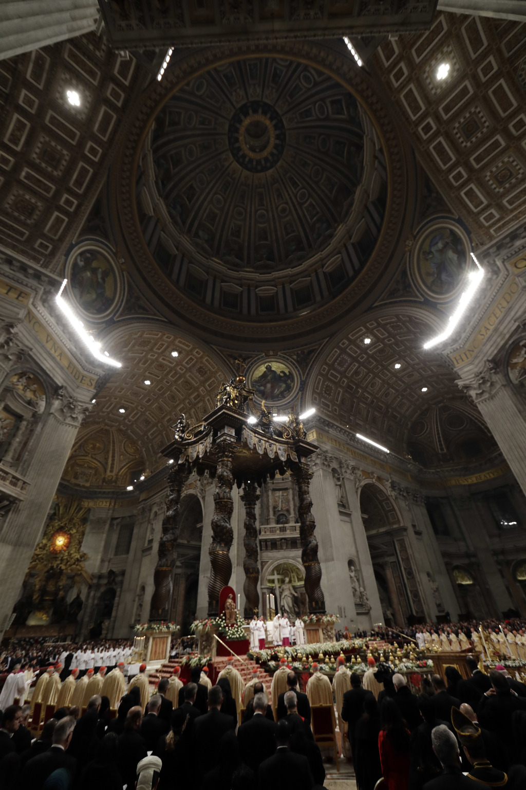 Faithful gather in St. Peter's Basilica during the Christmas Eve Mass celebrated by Pope Francis at the Vatican, Saturday, Dec. 24, 201...